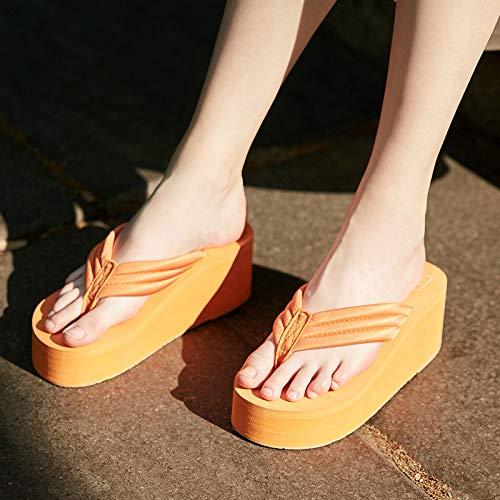 chanclas naranjas con plataforma